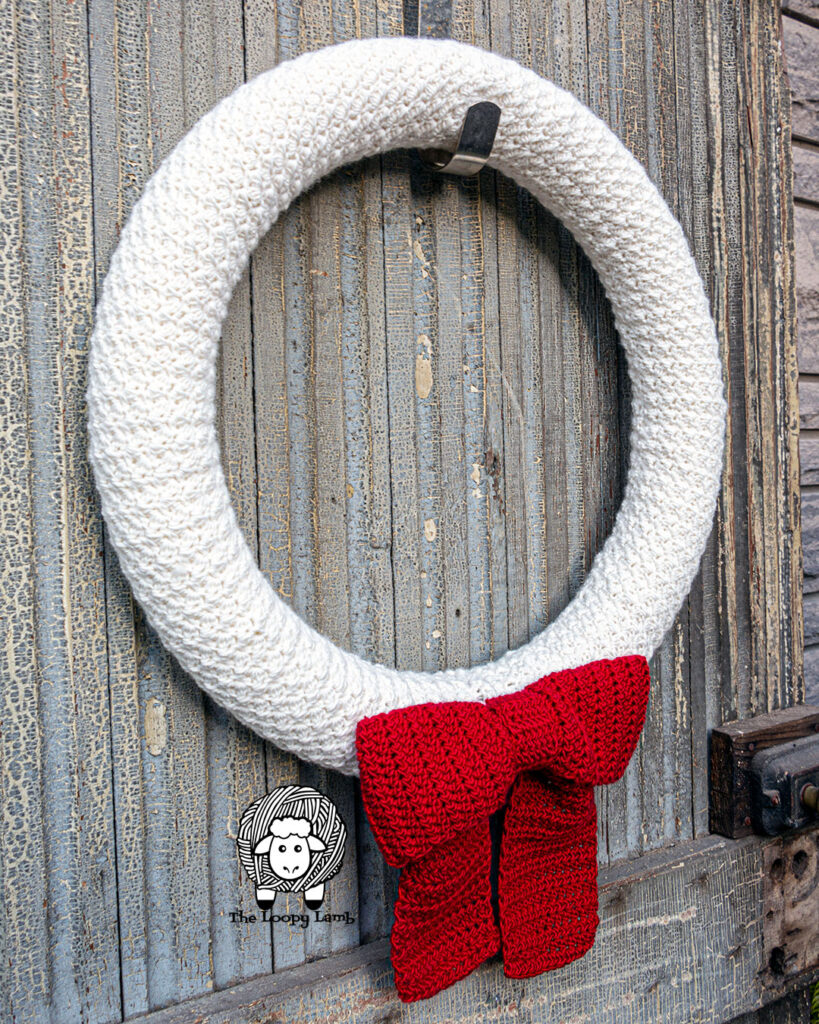 White Crochet Wreath with a large red bow