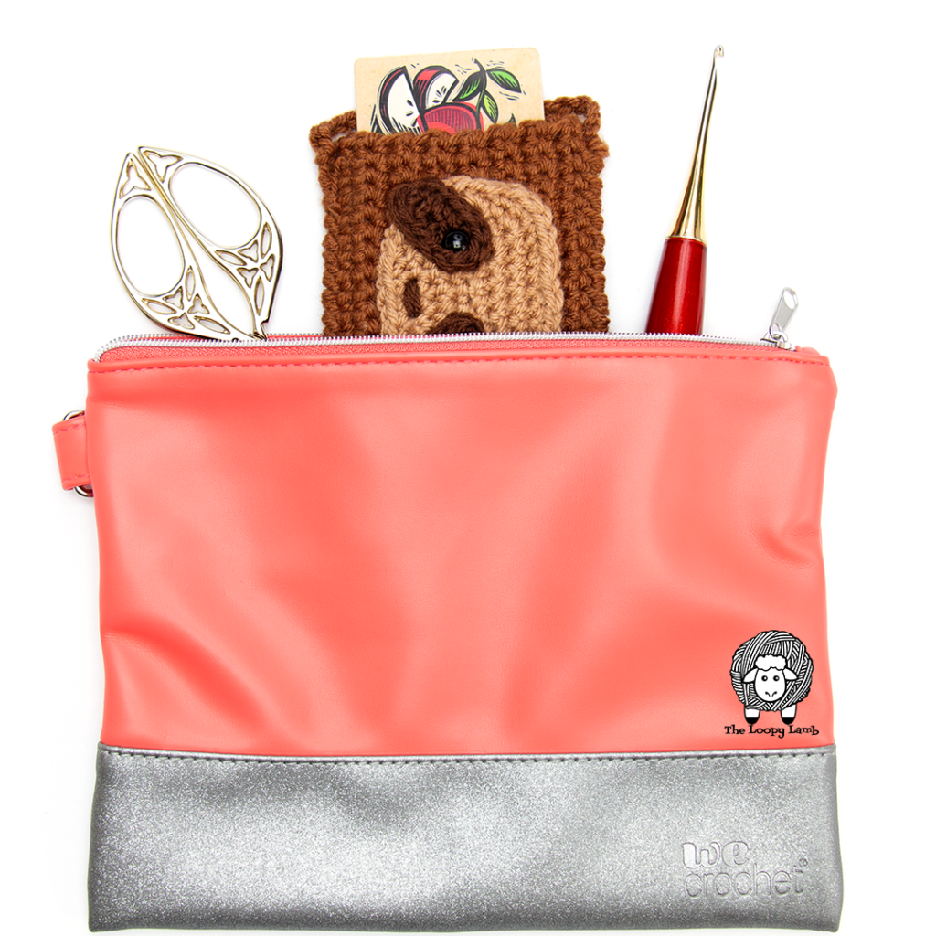 We Crochet Accessory Bag with a gift card holder and tools peeking out the top