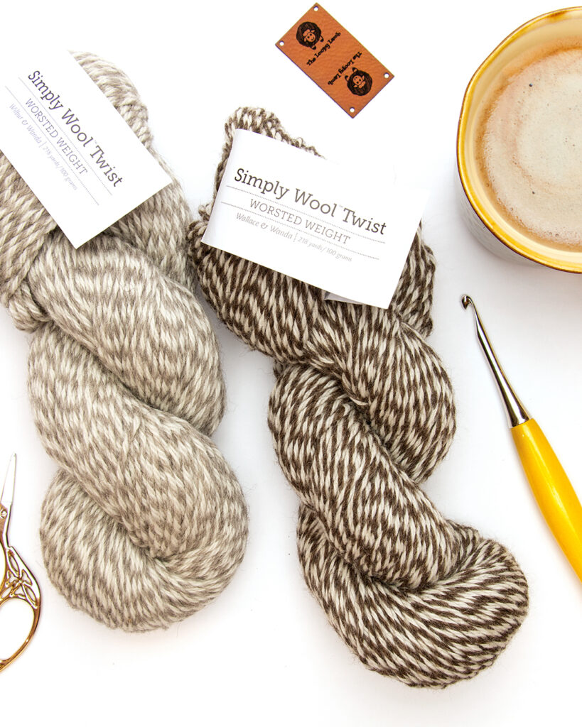 Two hanks of Simply Wool Worsted Twist in shades of brown and white