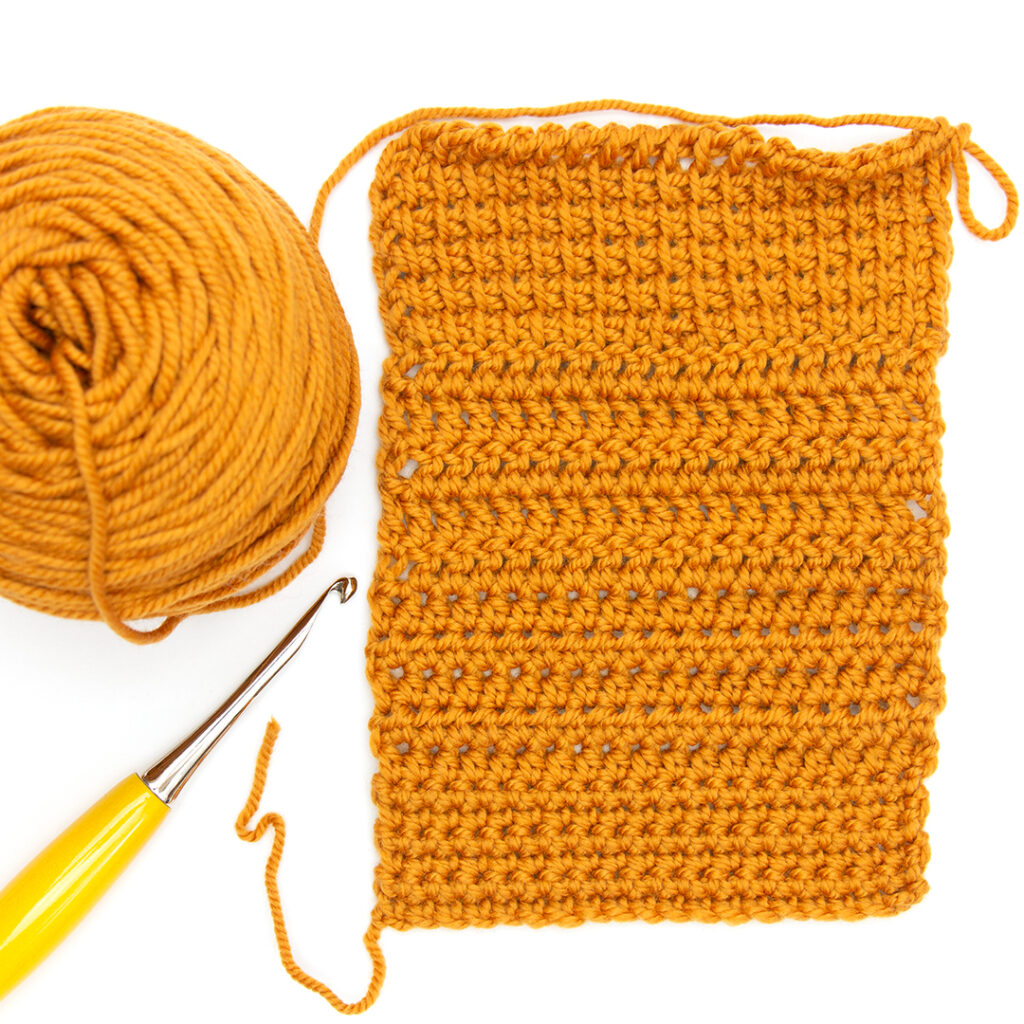 crochet swatch of twill worsted weight in gold rush