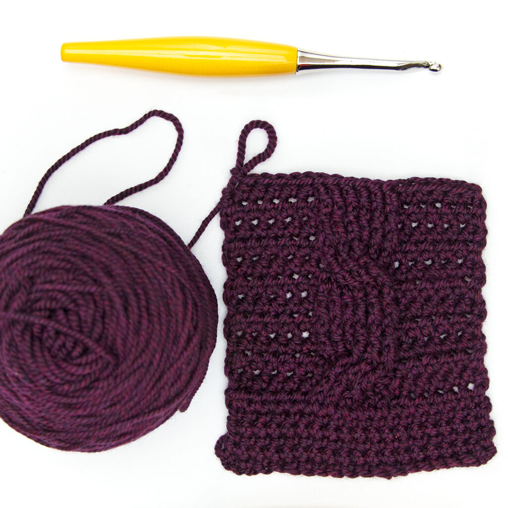 Black Cherry Heather Twill crocheted in a cable swatch