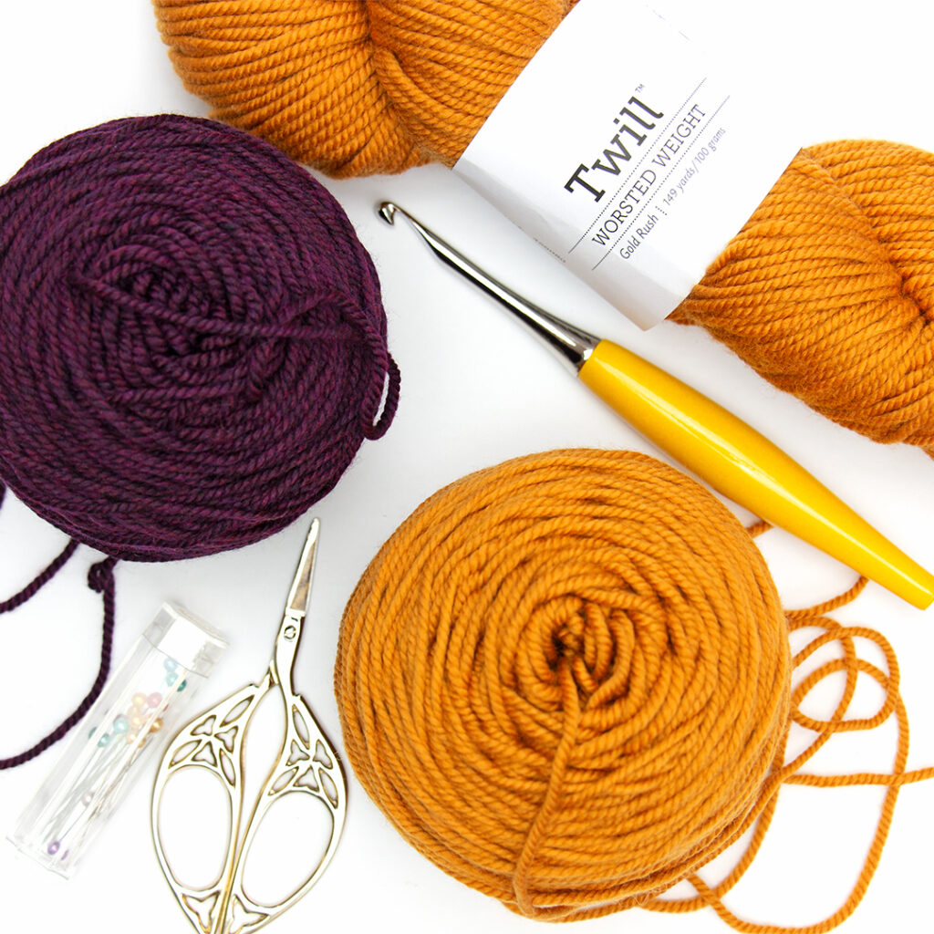 Caked up yarn and crochet accessories in a flat lay