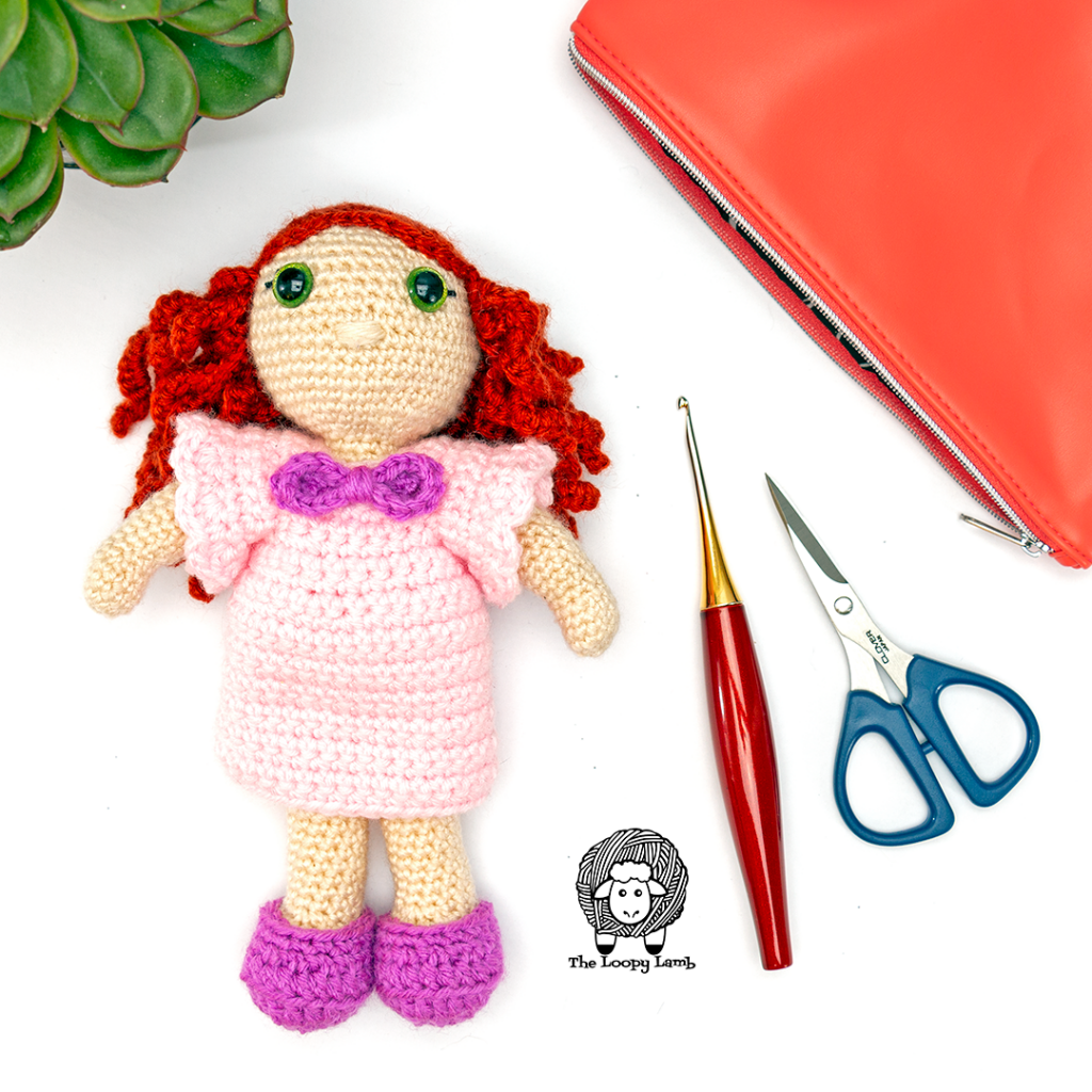 Crochet doll wearing a removeable nightgown and shoes