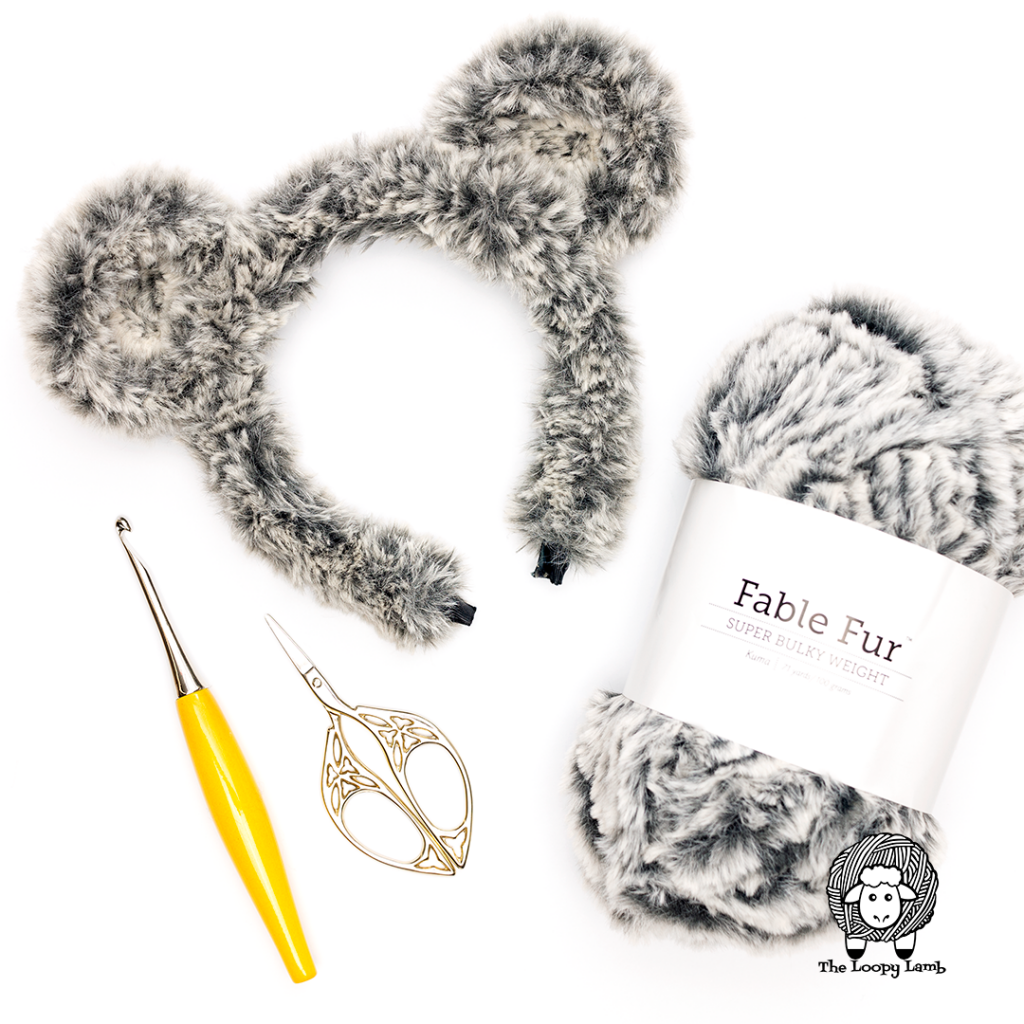 crochet bear ears in a flat lay with We Crochet Fable Fur and a Furls Odyssey Crochet Hook