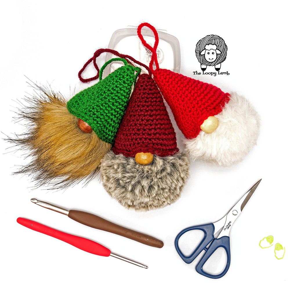 trio of crochet gnome tree ornaments made with this free crochet pattern.