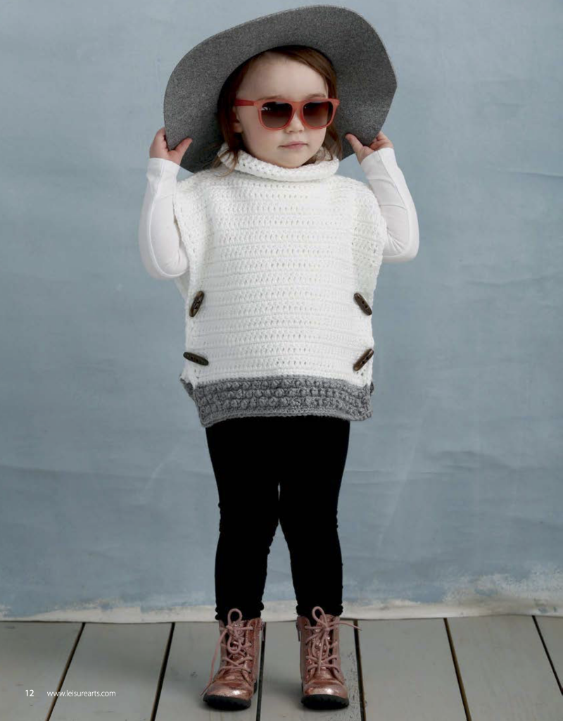 Child wearing a crochet poncho, sunglasses and sunhat