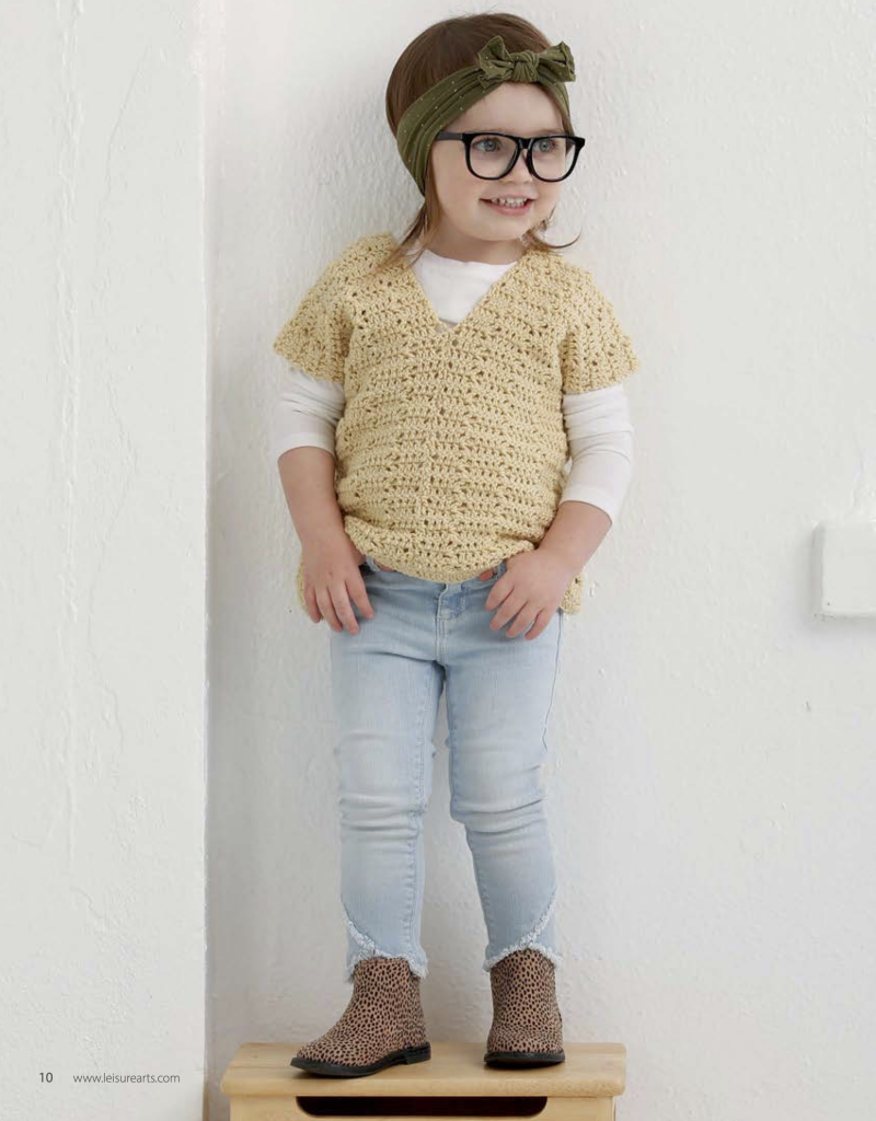 Hipster toddler wearing a crochet tunic made from the crochet patterns for toddlers in this book