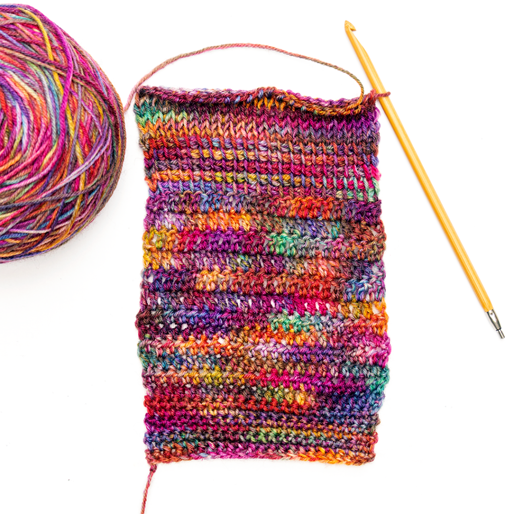 Bright multicoloured yarn in a crochet swatch