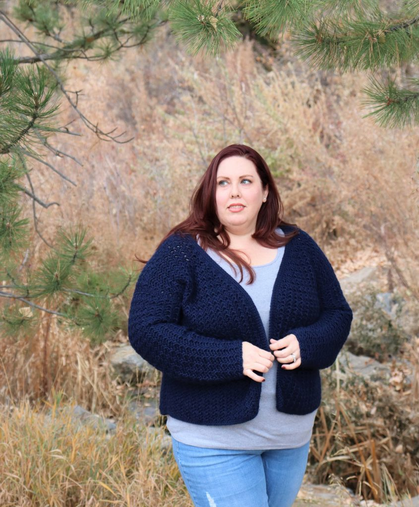 Plus size woman wearing a crochet cardigan
