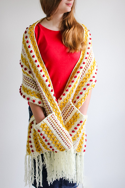 Textured crochet shawl with pockets being worn by a model