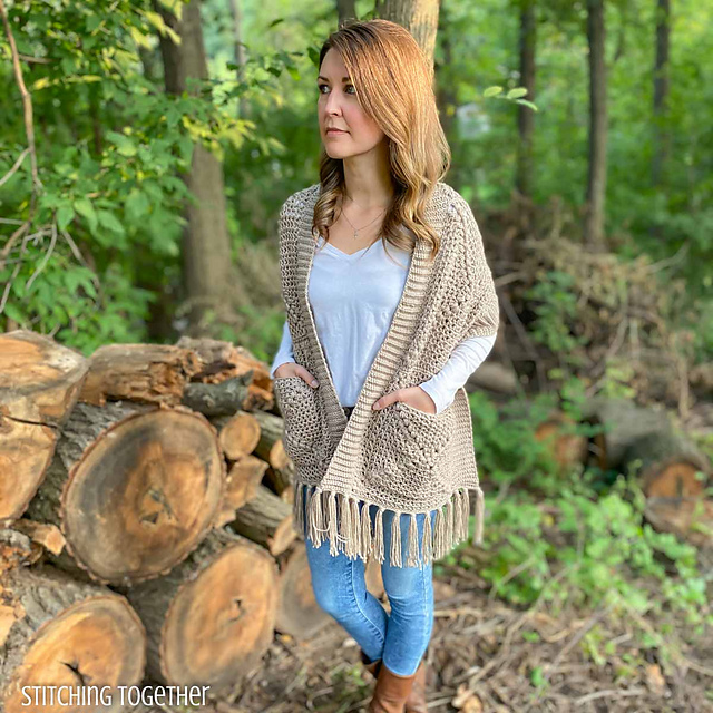 Crochet Shawl with pockets made from granny sqaures being modelled.