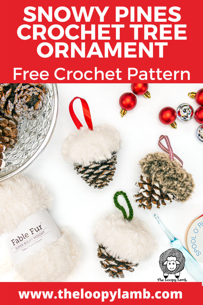 Pinecones topped with faux fur to look like snow, made with this free crochet christmas ornament pattern in a flat lay