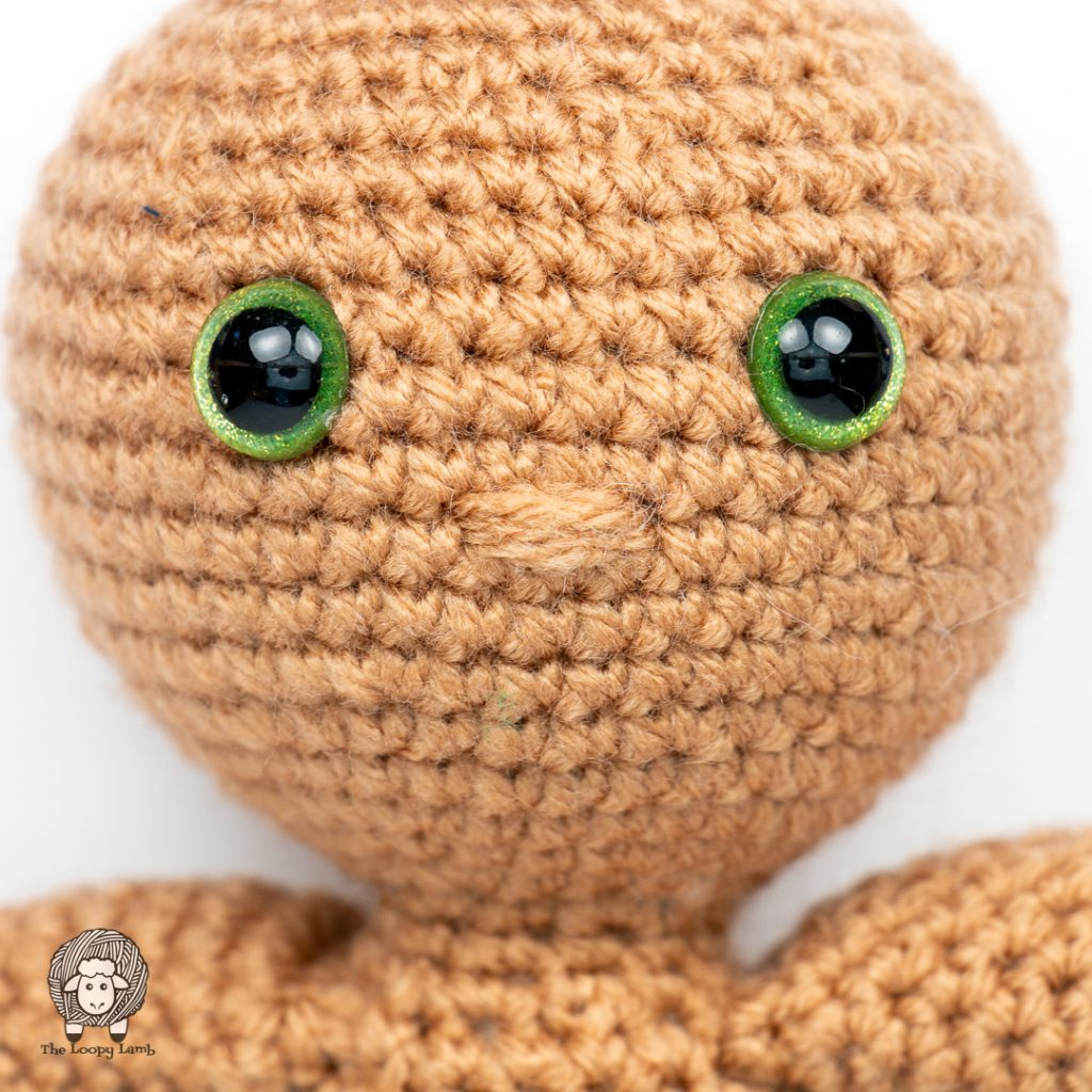 close up of the nose on the crochet boy doll being made with this free crochet along pattern