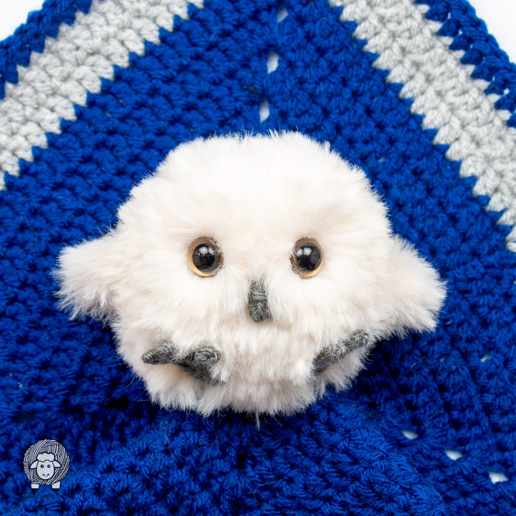 baby crochet owl on a blue crochet security blanket
