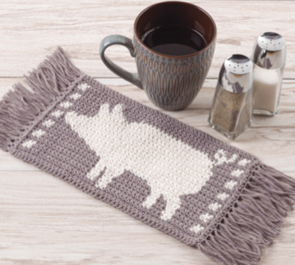 crochet mug mat with a pig on it from farmhouse mug mats