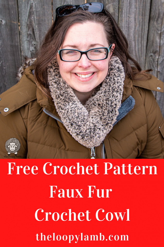 Smiling woman wearing a faux fur crochet cowl made with this free crochet pattern