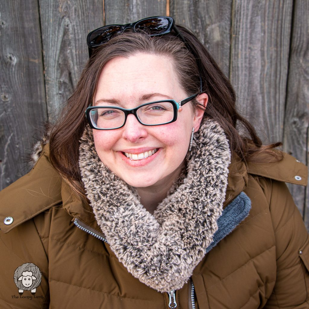 smiling brunette woman wearing a faux fur crochet cowl