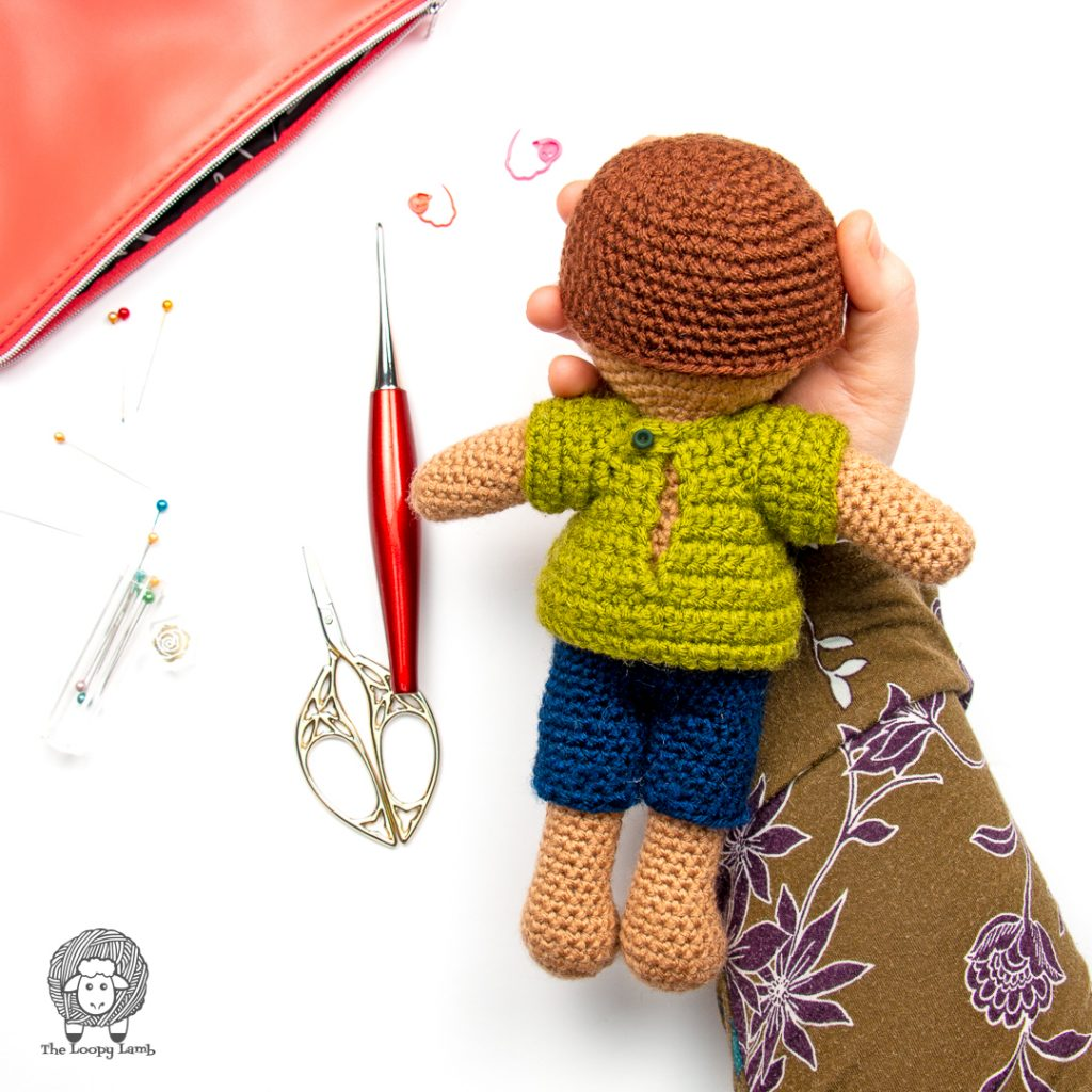 back view of the amigurumi doll clothes on the crochet doll
