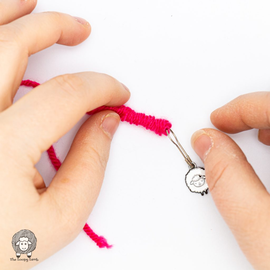 hands manipulating yarn into the russian join