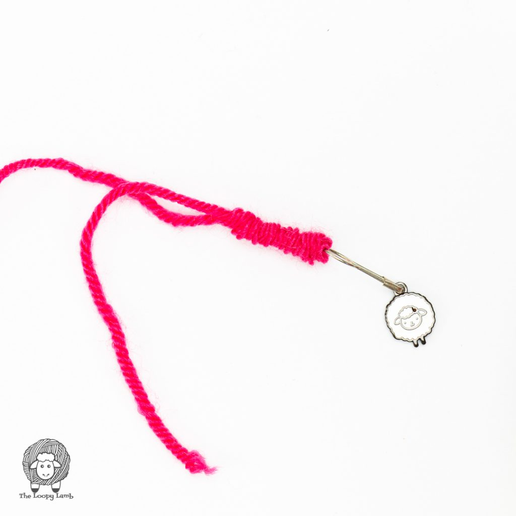 yarn bunched up on itself, holding a stitch marker