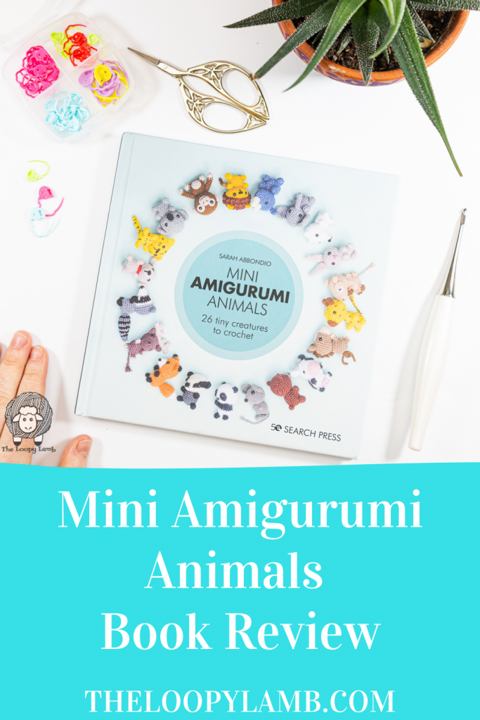 Cover of Mini Amigurumi Animals by Sarah Abbondio in a flat lay with crochet tools
