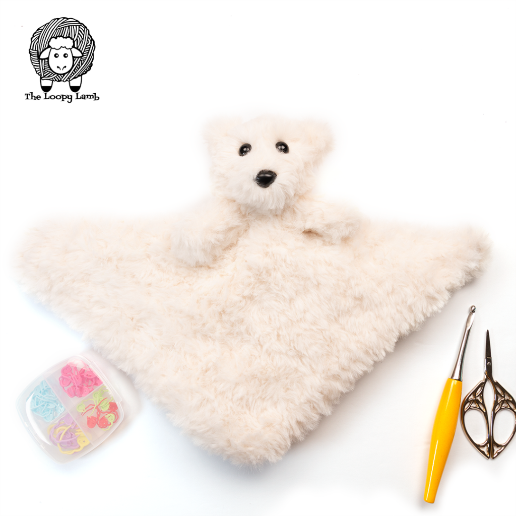 Teddy Bear Lovey with a fur blanket in a flat lay