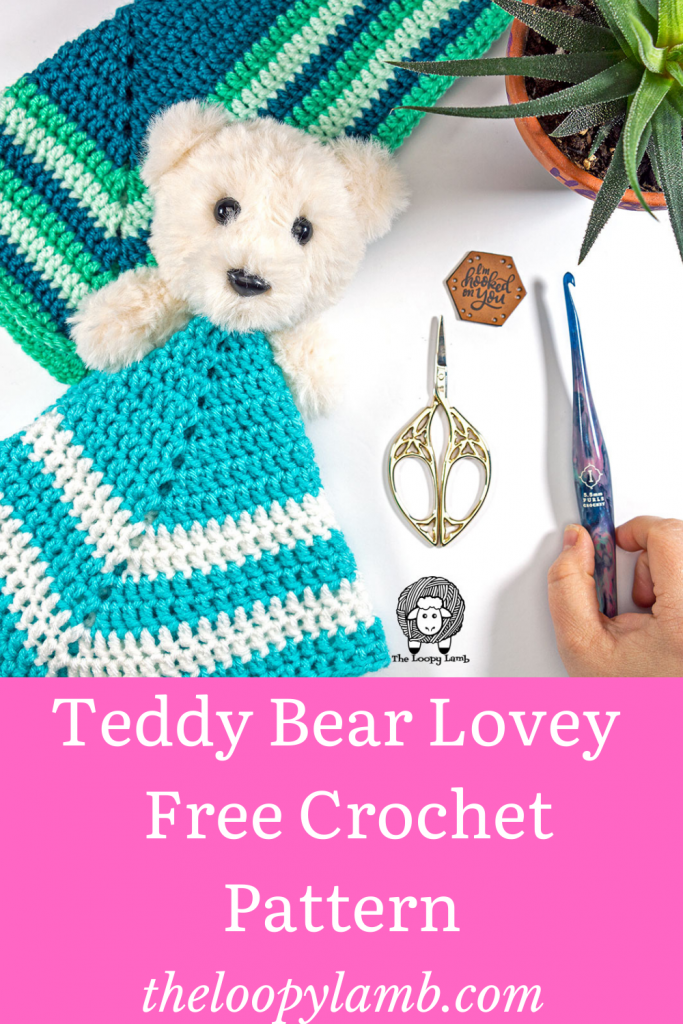 Teddy Bear Lovey made with this free crochet pattern in a flat lay with crochet accessories