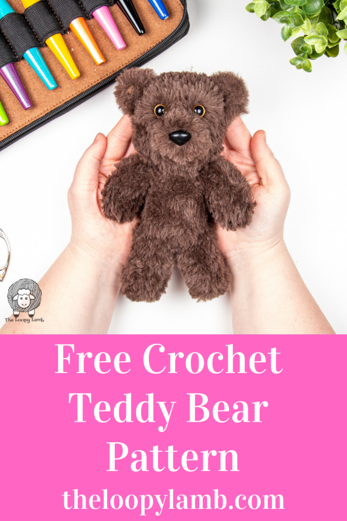 hands holding a furry crochet bear that was made with this free crochet teddy bear pattern