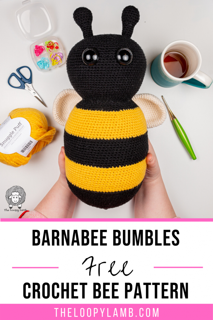 Large Amigurumi Bumble Bee made with this free crochet bee pattern, held in hands with text overlay indicating a free crochet pattern