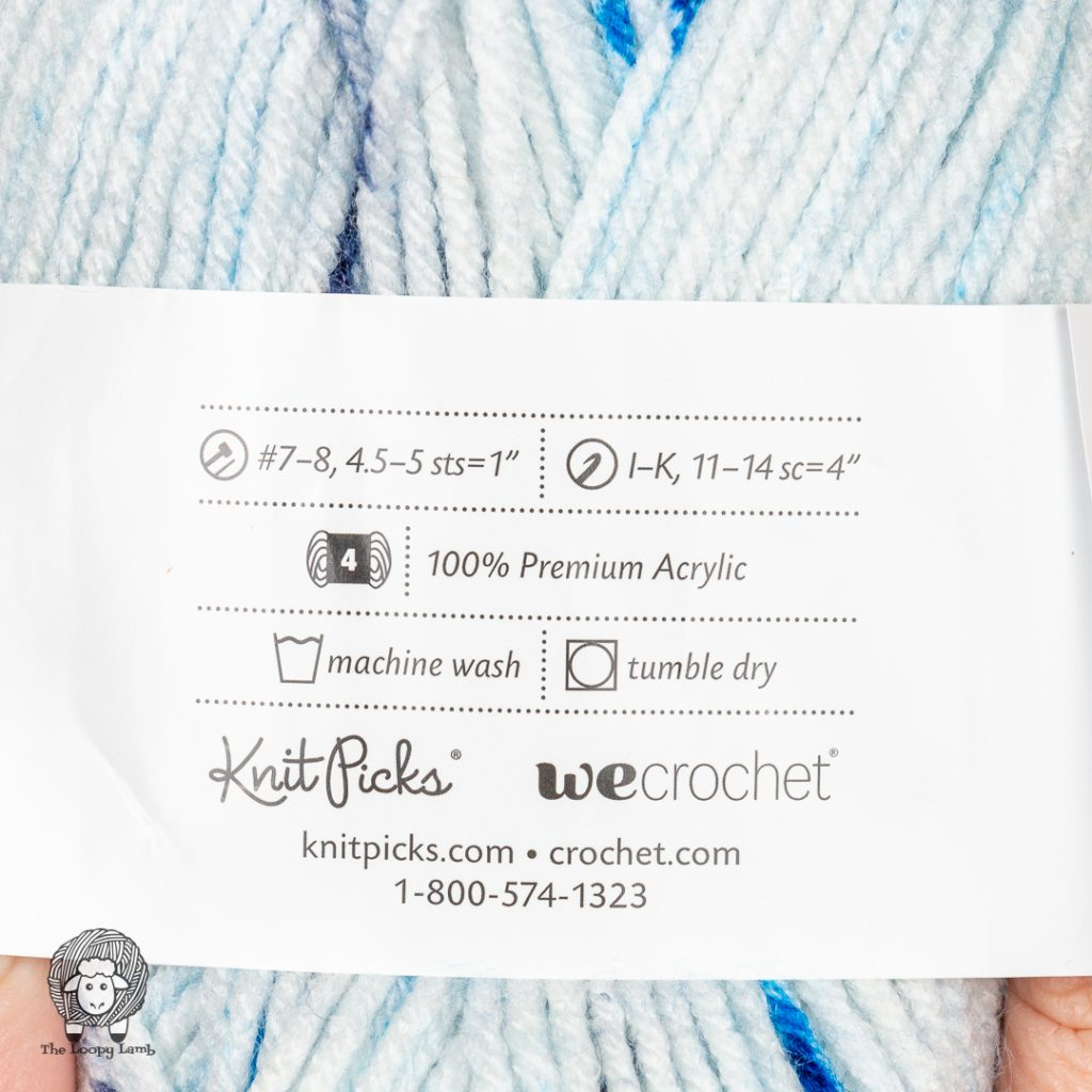 close up image of the Brava Worsted Speckle yarn label