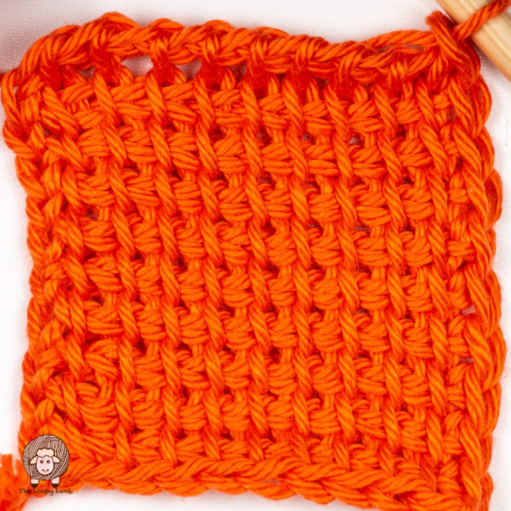 tunisian swatch done with the yarn being reviewed in grapefruit