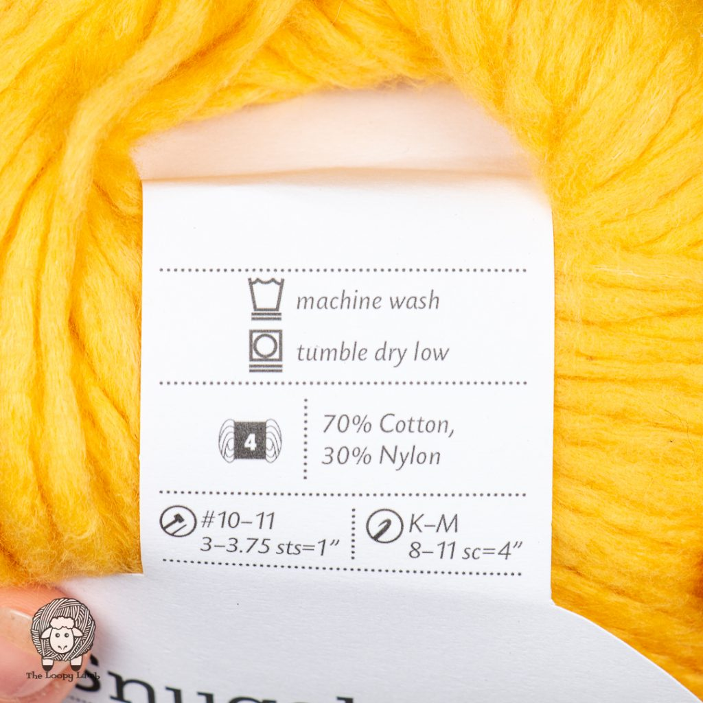 close up image of the Snuggle Puff Yarn Label